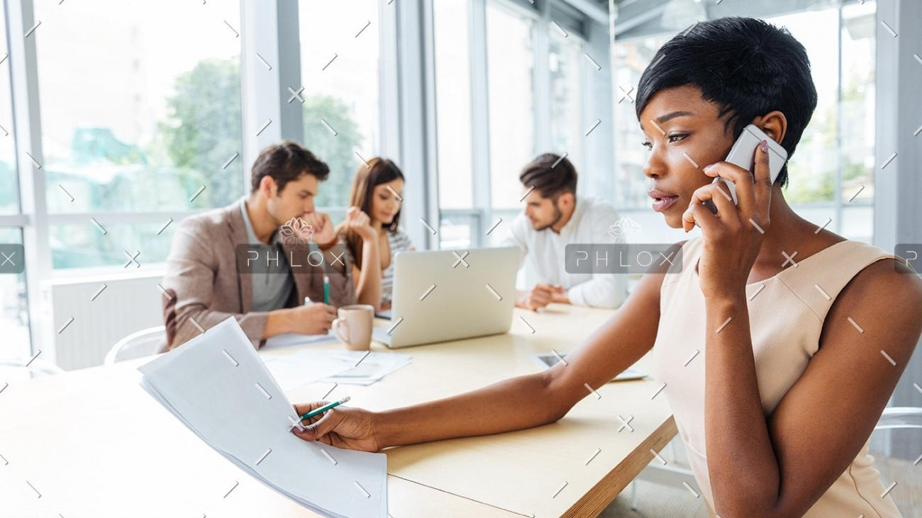 demo-attachment-133-serious-businesswoman-with-documents-talking-on-P9Q6LX6